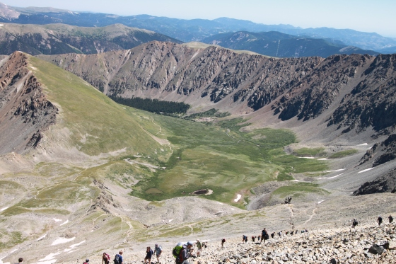 The view hiking back down Grays Peak. There were still a ton of people on the trail heading up as we were heading down. Every switchback was dotted with people. The dark foresty area is were the trailhead is.