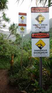 Many signs warning visitors not to go in the water at Hanakapi'ai Beach.